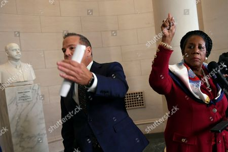 Stock Picture of David Cicilline, Sheila Jackson Lee. Rep. David Cicilline, D-R.I., left, and Rep. Sheila Jackson Lee, D-Texas, right, call their colleagues over to speak to reporters during a break in the House Judiciary Committee hearing on Capitol Hill in Washington, on the constitutional grounds for the impeachment of President Donald Trump