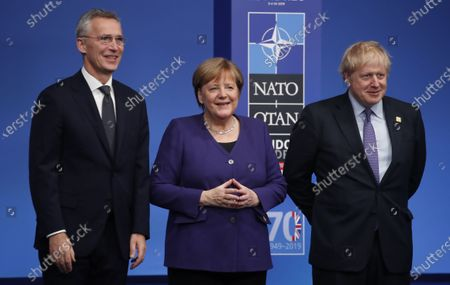 NATO Secretary General Jens Stoltenberg and Britain's Prime Minister Boris Johnson welcome Germany's Chancellor Angela Merkel