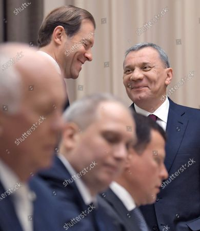 Minister of Industry and Trade of Russia Denis Manturov (center) and Deputy Prime Minister of Russia Yury Borisov (right) during the meeting on military construction and development of the military-industrial complex (MIC) at the Bocharov Ruchey residence.
