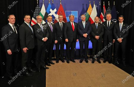 A handout picture provided by the British Ministry of Defence (MoD) shows (L-R) British Foreign Secretary Dominic Raab, Estonia's Prime Minister Juri Ratas, President of Latvia Egils Levits, Polish President Andrzej Duda, NATO Secretary General Jens Stoltenberg, US President Donald Trump, Romania's President Klaus Iohannis, Bulgaria's President Rumen Radev, President of Lithuania Gitanas Nauseda and Greek Prime Minister Kyriakos Mitsotakis during NATO Summit in London, Britain, 04 December 2019. NATO countries' heads of states and governments gather in London for a two-day meeting.