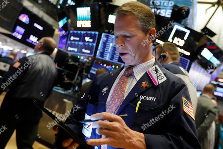 Trader Robert Charmak works on the floor of the New York Stock Exchange, . Stocks are opening broadly higher as traders became more hopeful that a trade deal between the U.S. and China was making progress