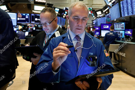 Robert Arciero, Timothy Nick. Traders Robert Arciero, left, and Timothy Nick work on the floor of the New York Stock Exchange, . Stocks are opening broadly higher as traders became more hopeful that a trade deal between the U.S. and China was making progress