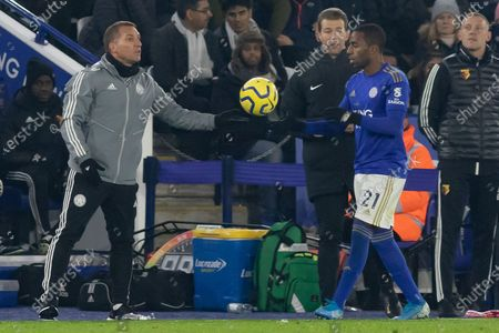 Brendan Rodgers hands the ball to Ricardo Pereira (21) during the Premier League match between Leicester City and Watford at the King Power Stadium, Leicester
