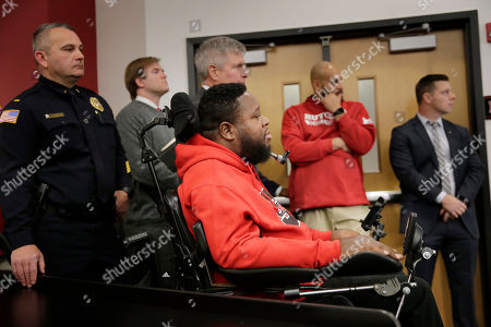 Stock Photo of Former Rutgers football player Eric LeGrand attends an introductory news conference in Piscataway, N.J.,. After an on-again, off-again courtship, Greg Schiano is back as Rutgers football coach
