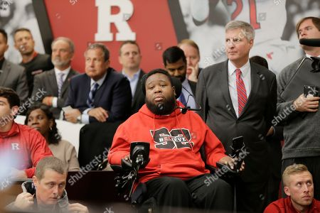 Former Rutgers football player Eric LeGrand attends an introductory news conference in Piscataway, N.J.,. After an on-again, off-again courtship, Greg Schiano is back as Rutgers football coach