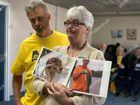 """Sandy Ray, holds photos of her son, Steven Davis, during a press conference at the Alabama Statehouse in Montgomery on . Davis died in 2019 after an altercation with corrections officers at the prison where he was incarcerated. Ray said she has received little information about his death. The Alabama Department of Corrections has said it is investigating Davis' death and that officers used """"physical measures"""" after he rushed at officers. Ray stands with her brother Randy Watson, as she addresses reporters. Ray later showed the photo to the governor's study commission on criminal justice issues"""
