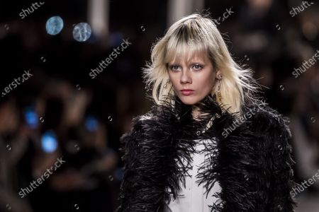 Dutch model Marjan Jonkman presents a creation during the Chanel Metiers d'Art 2019/2020 show held at the Grand Palais, in Paris, France, 04 December 2019. Chanel recreated the iconic curved mirrored staircase that lead to Coco Chanel's private apartment on Rue Cambon beneath the nave of the Grand Palais.