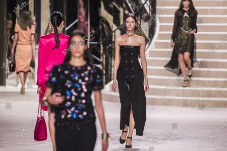 Stock Photo of Italian model Greta Varlese (C) presents a creation during the Chanel Metiers d'Art 2019/2020 show held at the Grand Palais, in Paris, France, 04 December 2019. Chanel recreated the iconic curved mirrored staircase that lead to Coco Chanel's private apartment on Rue Cambon beneath the nave of the Grand Palais.