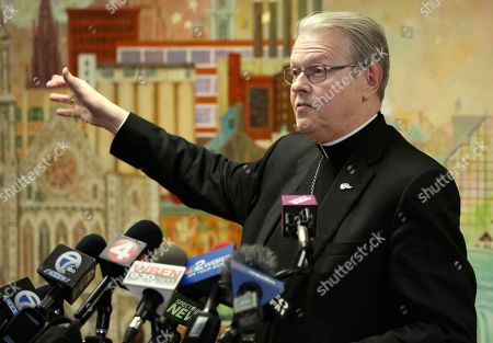 Albany Bishop Edward Scharfenberger addresses the media after being appointed by the Vatican to serve as Apostolic Administrator for the Buffalo Diocese until a replacement Bishop is chosen, in Buffalo N.Y. Bishop Richard Malone of Buffalo resigned Wednesday, forced to step aside amid mounting calls for his ouster from his staff, priests and public over his handling of allegations of clergy sexual misconduct