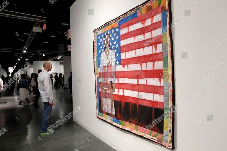 Art by Faith Ringgold titled The Flag is Bleeding is displayed at the Pippy Houldsworth Gallery during Art Basel Miami Beach, in Miami Beach, Fla. The annual exhibition features artwork from over 200 of the world's modern and contemporary art galleries