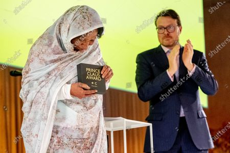 Dutch Prince Constantijn (R) applauds during the presentation of the Great Prince Claus Award 2019 to visual artist Kamala Ibrahim Ishag from Sudan, in Amsterdam, The Netherlands, 04 December 2019.