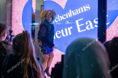 Stock Photo of Debenhams' TV ad star and singer, Fleur East, presses the button to switch on Manchester's Debenhams store Christmas lights
