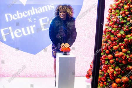 Fleur East presses the button to switch on the stores Christmas lights
