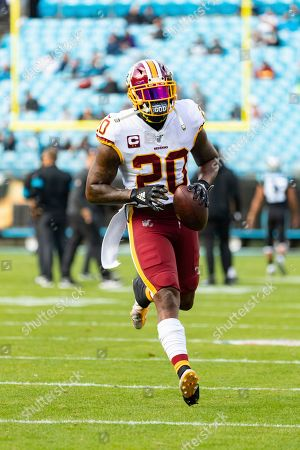 Stock Photo of Washington Redskins strong safety Landon Collins (20) as he warms up before taking on the Carolina Panthers during an NFL game at Bank of America Stadium in Charlotte, N.C. on