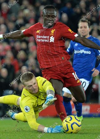 Sadio Mane of Liverpool gets around goalkeeper Jordan Pickford of Everton but fails to score during the English Premier League soccer match between Liverpool FC and Everton in Liverpool, Britain, 04 December 2019.