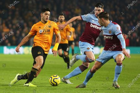 Raul Jimenez takes on Aaron Cresswell and Declan Rice during the Premier League match between Wolverhampton Wanderers and West Ham United at Molineux, Wolverhampton