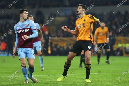 Raul Jimenez and Aaron Cresswell in action during the Premier League match between Wolverhampton Wanderers and West Ham United at Molineux, Wolverhampton