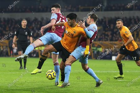 Raul Jimenez competes with Aaron Cresswell and Declan Rice for the ball during the Premier League match between Wolverhampton Wanderers and West Ham United at Molineux, Wolverhampton