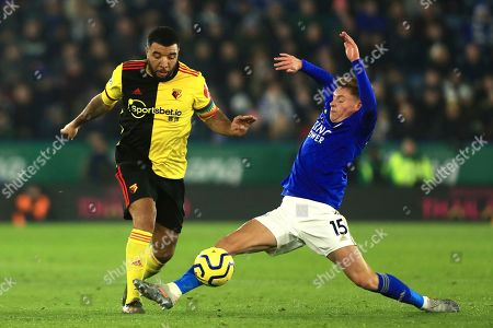 Watford's Troy Deeney wins the ball from Leicester's Harvey Barnes during the English Premier League soccer match between Leicester City and Watford at the King Power Stadium, in Leicester, England