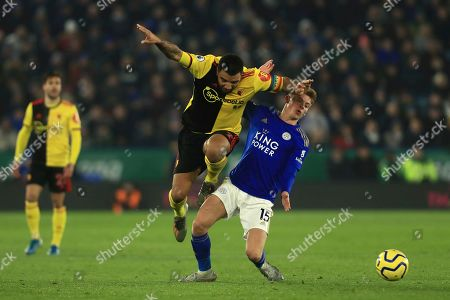 Watford's Troy Deeney challenges for the ball against Leicester's Harvey Barnes during the English Premier League soccer match between Leicester City and Watford at the King Power Stadium, in Leicester, England