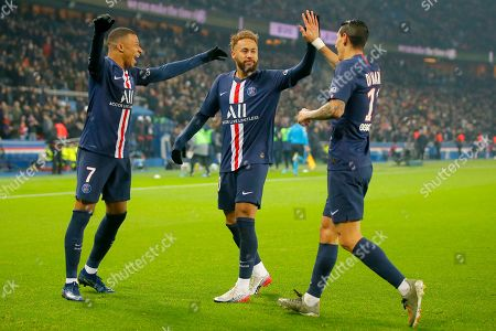 PSG's Kylian Mbappe, left, celebrates with PSG's Neymar, center and PSG's Angel Di Maria after scoring his side's opening goal during the French League One soccer match between PSG and Nantes at the Parc des Princes stadium in Paris