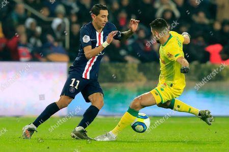 PSG's Angel Di Maria, left, fights for the ball with Nantes Mehdi Abeid during the French League One soccer match between PSG and Nantes at the Parc des Princes stadium in Paris