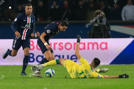 PSG's Angel Di Maria, center, is tackled by Nantes Mehdi Abeid during the French League One soccer match between PSG and Nantes at the Parc des Princes stadium in Paris