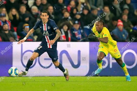 Stock Photo of PSG's Angel Di Maria, left, is chased by Nantes Charles Traore during the French League One soccer match between PSG and Nantes at the Parc des Princes stadium in Paris