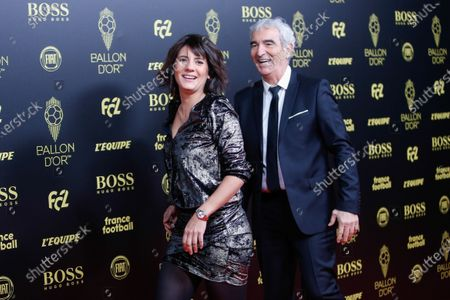 Stock Picture of Former French national football team coach Raymond Domenech and French journalist Estelle Denis joke as they arrive