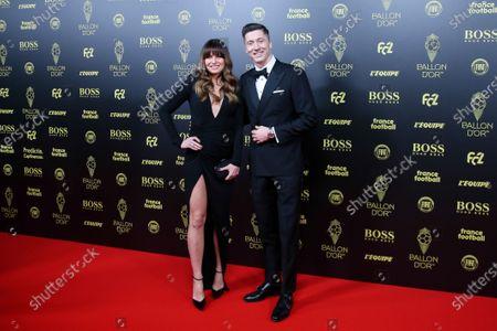 Stock Photo of Bayern Munich's Polish soccer player Robert Lewandowski and his athlete wife Anna Lewandowska arrive