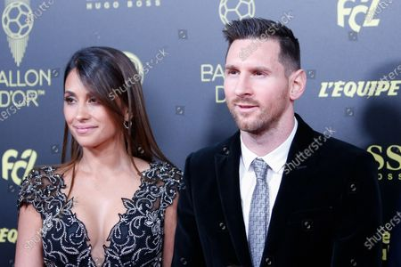 Barcelona's Argentinian forward Lionel Messi and his wife Antonella Roccuzzo arrive