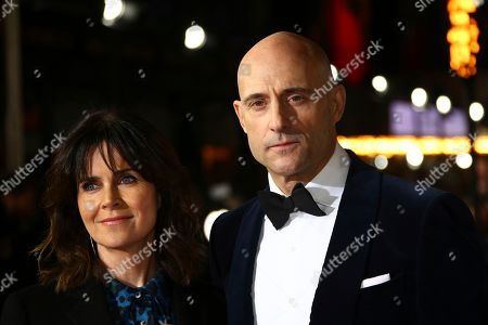 Liza Marshall, Mark Strong. Liza Marshall and Mark Strong pose for photographers upon arrival at the World premiere of the film '1917', in central London