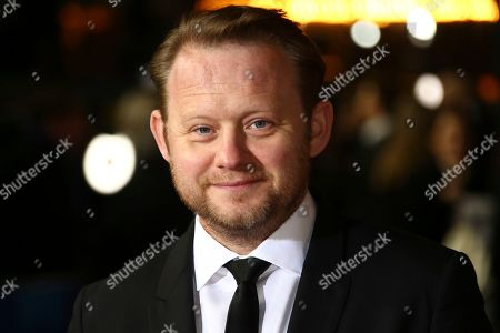 Michael Jibson poses for photographers upon arrival at the World premiere of the film '1917', in central London