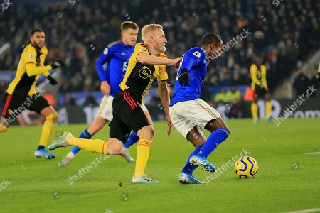 Watford's Will Hughes battling for the ball against Leicester's Ricardo Pereira during the English Premier League soccer match between Leicester City and Watford at the King Power Stadium, in Leicester, England
