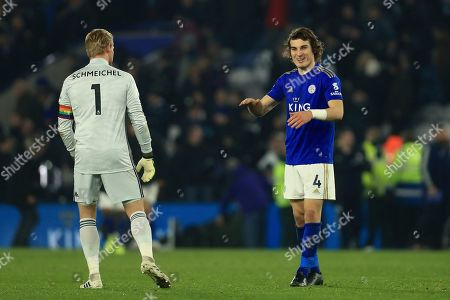 Leicester's Caglar Soyuncu celebrates his sides with Leicester's goalkeeper Kasper Schmeichel left after the English Premier League soccer match between Leicester City and Watford at the King Power Stadium, in Leicester, England