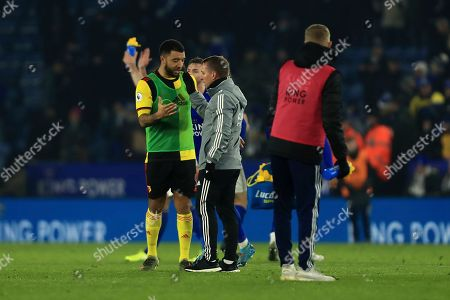 Watford's Troy Deeney embraces Leicester's manager Brendan Rodgers after the English Premier League soccer match between Leicester City and Watford at the King Power Stadium, in Leicester, England