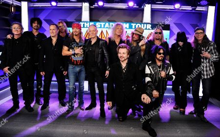 Stock Photo of Rick Allen, Tommy Lee, Vivian Campbell, Joe Elliott, Bret Michaels, Phil Collen, Rick Savage, Rikki Rokkett, C.C. DeVille, Nikki Sixx, Vince Neil, Mick Mars, Bobby Dall. Musicians Rick Allen, from left, Tommy Lee, Vivian Campbell, Joe Elliott, Bret Michaels, Phil Collen, Rick Savage, Rikki Rokkett (kneeling), C.C. DeVille, Nikki Sixx (kneeling), Vince Neil, Mick Mars and Bobby Dall pose together following a news conference to announce The Stadium Tour 2020 featuring rock bands Motley Crew, Def Leppard and Poison, at the SiriusXM offices, in Los Angeles