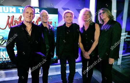 Stock Image of Vivian Campbell, Phil Collen, Rick Allen, Rick Savage, Joe Elliott. Vivian Campbell, from left, Phil Collen, Rick Allen, Rick Savage and Joe Elliott of Def Leppard pose together following a news conference to announce The Stadium Tour 2020 featuring Def Leppard, Poison and Motley Crue, at the SiriusXM offices, in Los Angeles