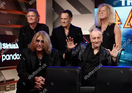 Stock Photo of Rick Allen, Joe Elliott, Vivian Campbell, Phil Collen, Rick Savage. Rick Allen, from left, Joe Elliott, Vivian Campbell, Phil Collen and Rick Savage of Def Leppard sit for a a news conference to announce The Stadium Tour 2020 featuring Def Leppard, Poison and Motley Crue, at the SiriusXM offices, in Los Angeles