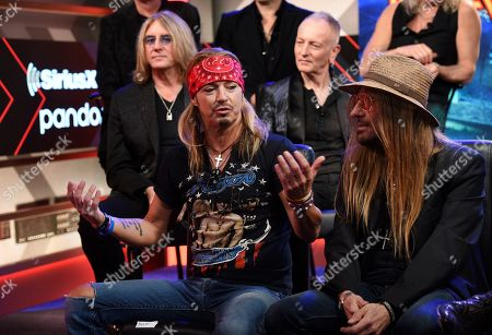 Stock Photo of Bret Michaels, C C DeVille, Joe Elliott, Phil Collen. Bret Michaels, center, of Poison, answers a question as bandmate C C DeVille, right, looks on during a news conference to announce The Stadium Tour 2020 featuring Poison, Def Leppard and Motley Crue, at the SiriusXM offices, in Los Angeles. Looking on in the background are Joe Elliott, left, and Phil Collen of Def Leppard