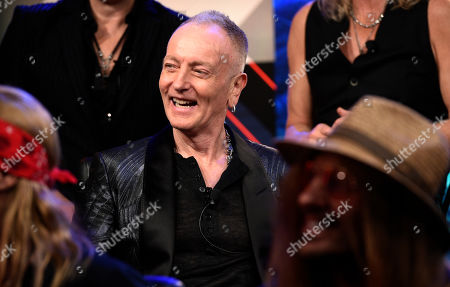 Stock Image of Phil Collen of Def Leppard laughs during a news conference to announce The Stadium Tour 2020 featuring Def Leppard, Poison and Motley Crue, at the SiriusXM offices, in Los Angeles