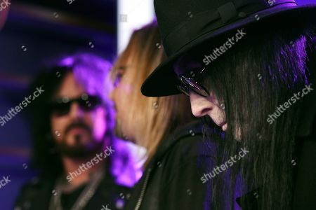 Stock Photo of Mick Mars of Motley Crue, right, looks on during a news conference to announce The Stadium Tour 2020 featuring Motley Crue, Poison and Def Leppard, at the SiriusXM offices, in Los Angeles