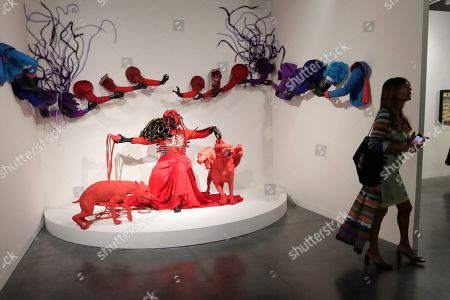 Stock Picture of An installation by artist Mary Sibande is shown at the Kavi Gupta Gallery during Art Basel Miami Beach, in Miami Beach, Fla.The annual exhibition features artwork from over 200 of the world's modern and contemporary art galleries