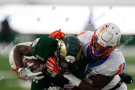 R m. Boise State cornerback Tyric LeBeauf, right, tackles Colorado State wide receiver Warren Jackson (9) in the second half of an NCAA college football game, in Fort Collins, Colo. Boise State won 31-24