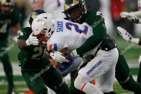 R m. Boise State wide receiver Khalil Shakir (2) is tackled by Colorado State cornerback Marshaun Cameron, back left, and Colorado State linebacker Cam'ron Carter (12) in the second half of an NCAA college football game, in Fort Collins, Colo. Boise State won 31-24