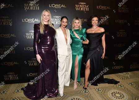 Iskra Lawrence, Cara Santana, Witney Carson, Kat Graham. Model Iskra Lawrence, from left, actress Cara Santana, dancer Witney Carson and actress Kat Graham pose together at the 14th annual L'Oreal Paris Women of Worth Gala at the Pierre Hotel, in New York