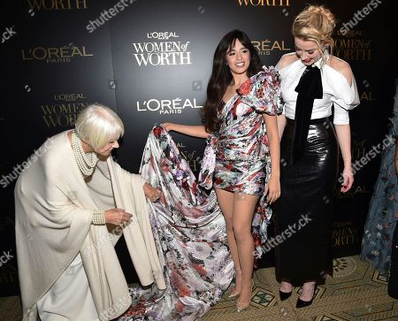 Stock Photo of Helen Mirren, Camila Cabello, Amber Heard. Dame Helen Mirren, left, helps singer Camila Cabello with her outfit as actress Amber Heard stands by at the 14th annual L'Oreal Paris Women of Worth Gala at the Pierre Hotel, in New York