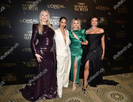 Stock Picture of Iskra Lawrence, Cara Santana, Witney Carson, Kat Graham. Model Iskra Lawrence, left, actress Cara Santana, dancer Witney Carson and actress Kat Graham pose together at the 14th annual L'Oreal Paris Women of Worth Gala at the Pierre Hotel, in New York