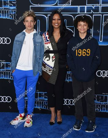 "Garcelle Beauvais, Jaid Thomas Nilon, Jax Joseph Nilon. Garcelle Beauvais, center, and her sons Jaid Thomas Nilon, left, and Jax Joseph Nilon arrive at the world premiere of ""Spies in Disguise"" at the El Capitan Theatre, in Los Angeles"
