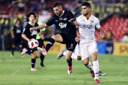 Adrian Martinez (L) of Libertad vies for the ball with Hernan Lopes of Guarani (R) during the final of Copa Paraguay soccer tournament at Defensores del Chaco stadium in Asuncion, Paraguay, 04 December 2019.